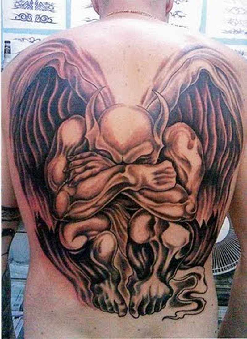 Big devil tattoo on back body