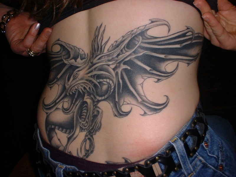 Big dragon tattoo on lowerback