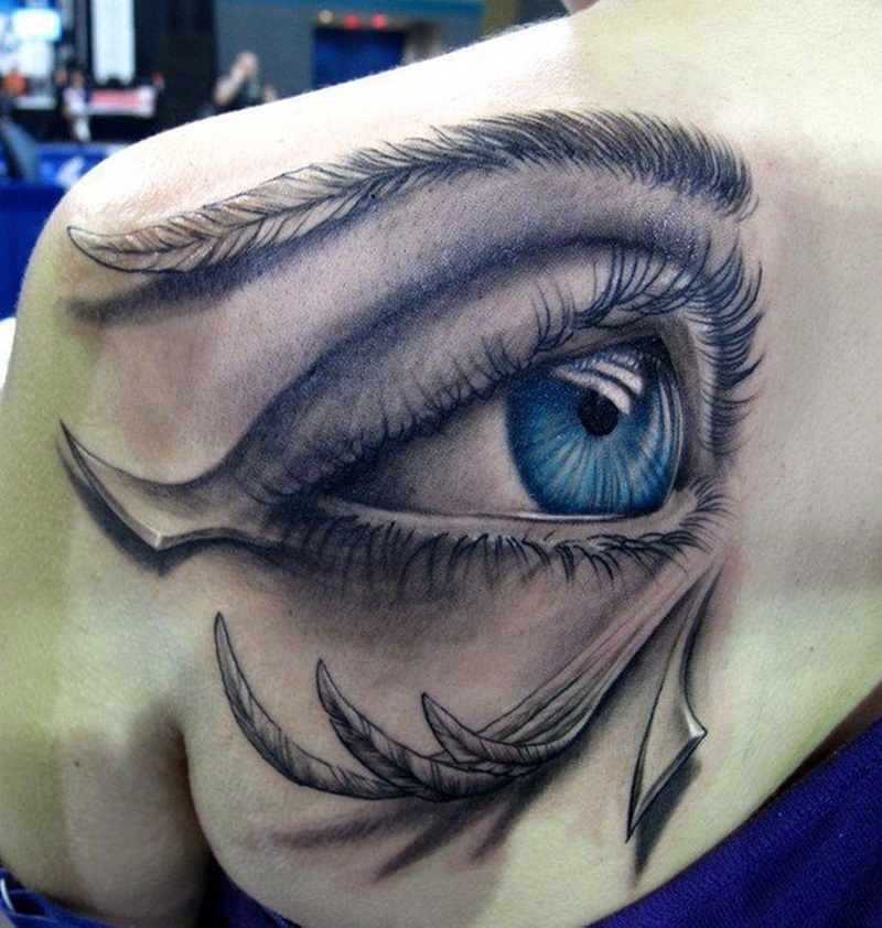Big eye tattoo on back shoulder