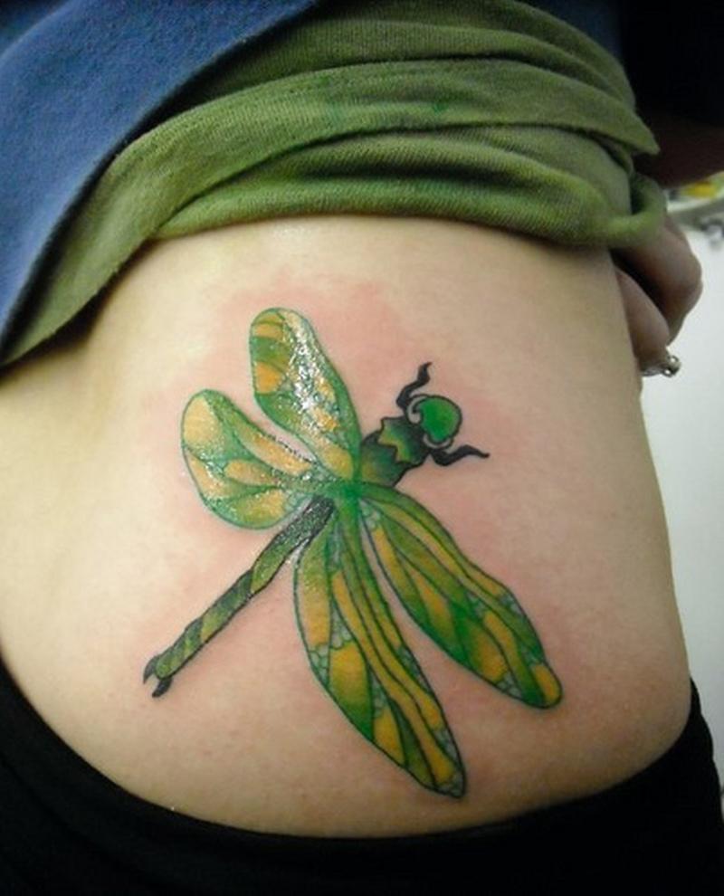 Big green dragonfly tattoo on waist