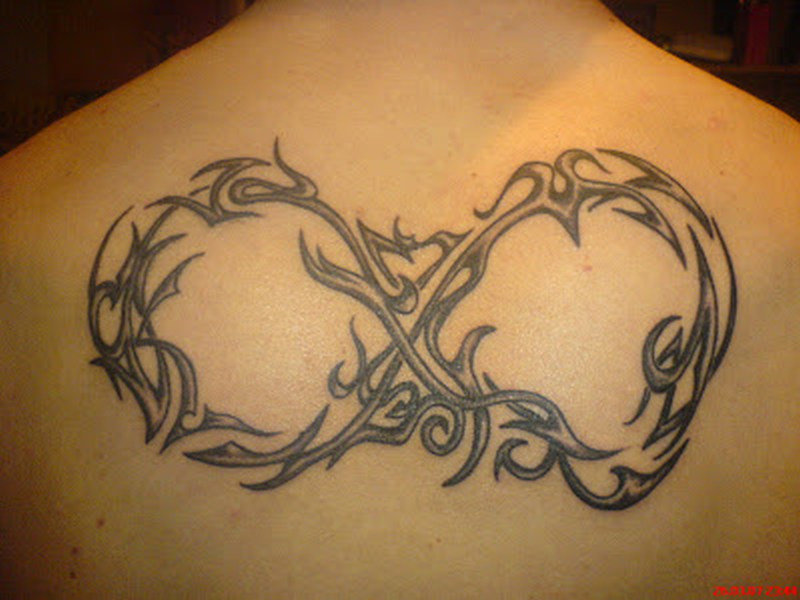 Big infinity tattoo on back