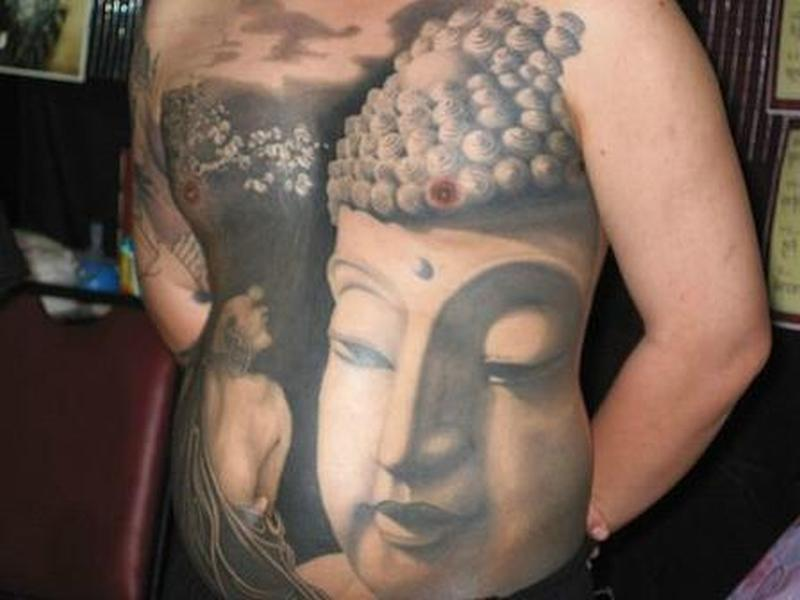 Big religious asian tattoo on body