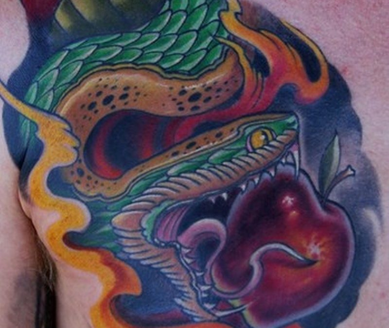 Big snake with apple tattoo on chest