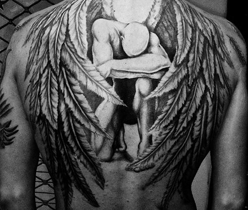 Big tattoo design of sad angel