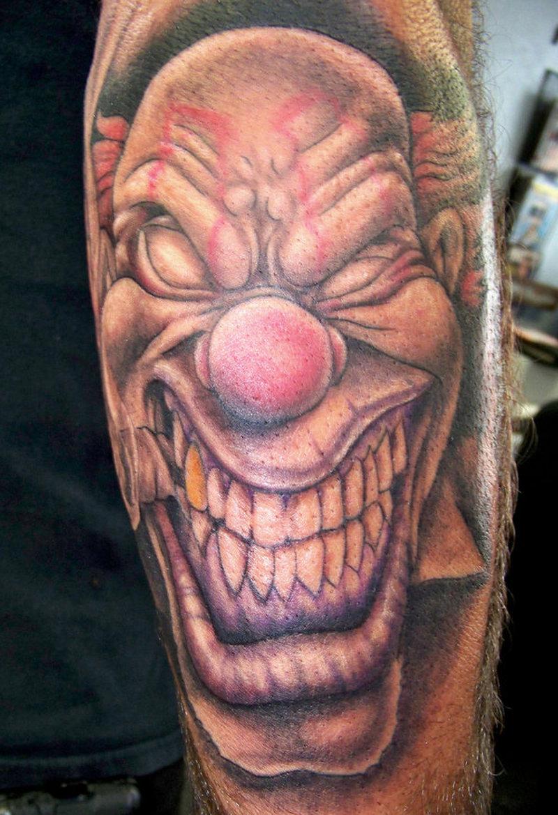 Big teeth clown head tattoo design