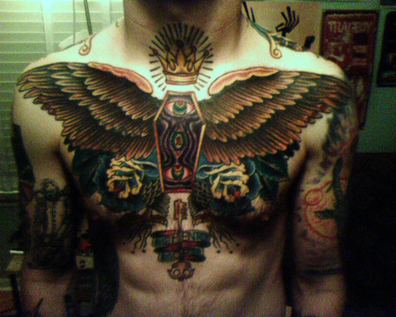 Big winged coffin tattoo on chest