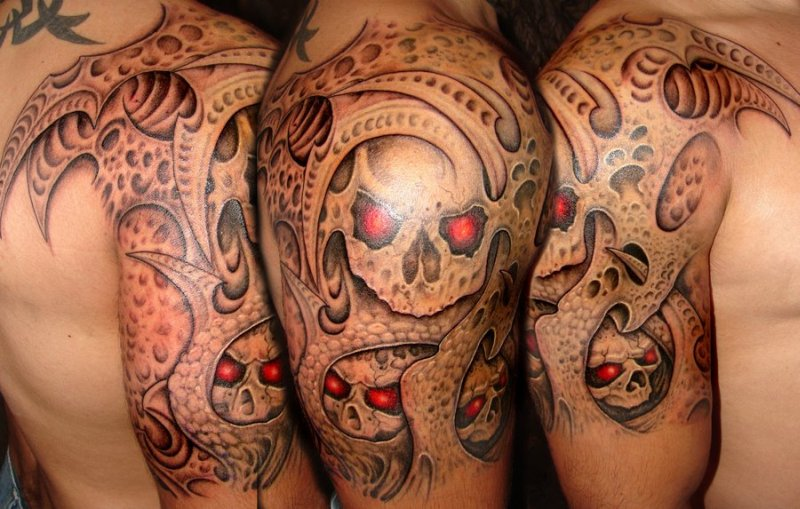 Bio skull horror tattoo design on shoulder