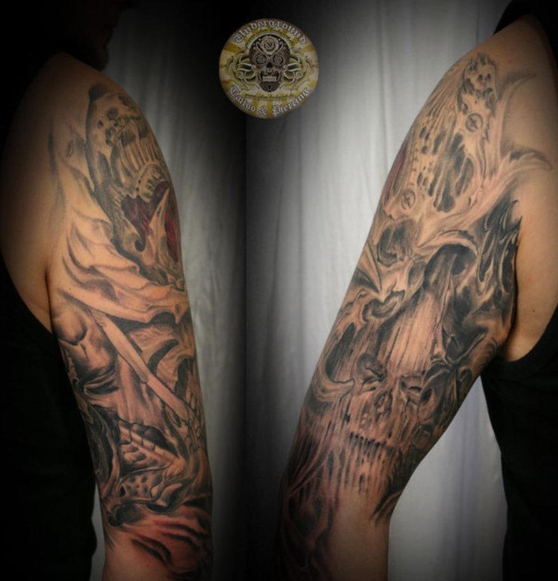 Biomech skull horror arm tattoo design 2