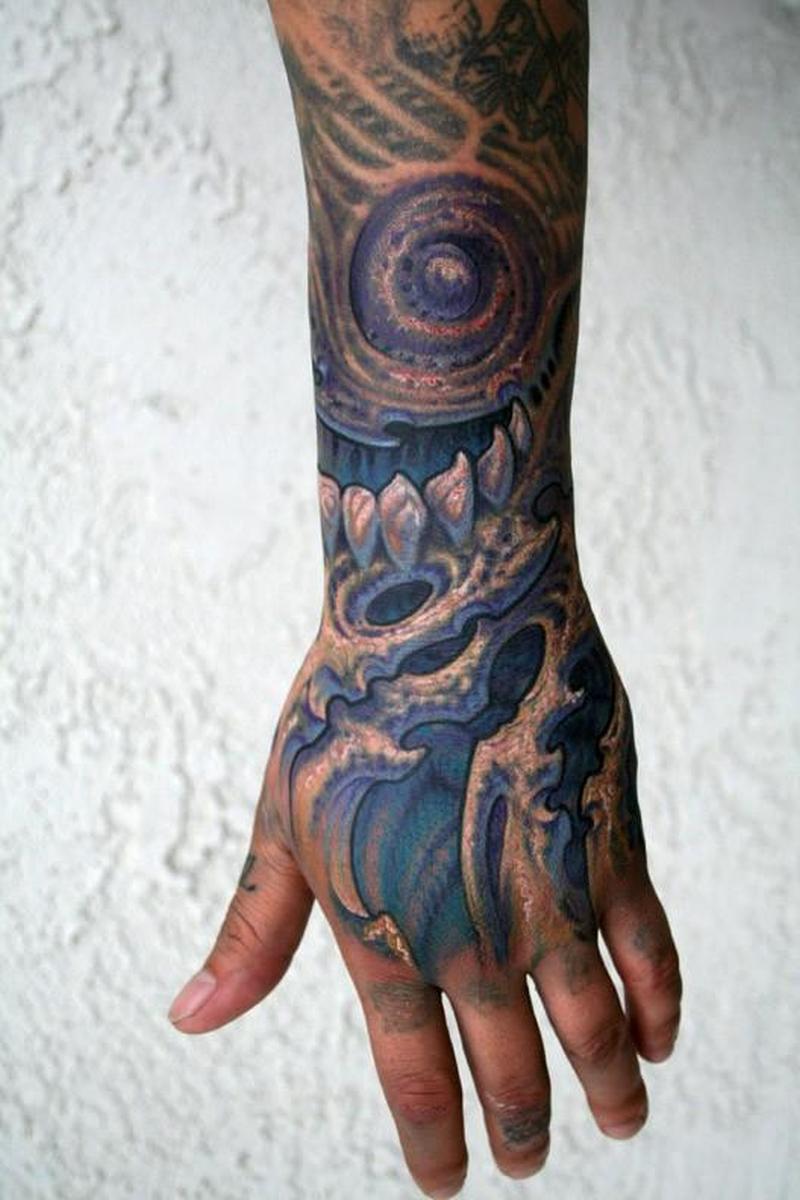 Biomechanical alien tattoo design on arm
