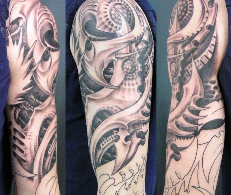 Biomechanical alien tattoo design on arms