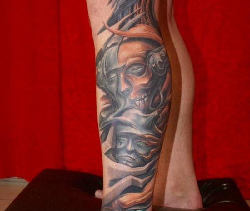 Biomechanical alien tattoo design on leg