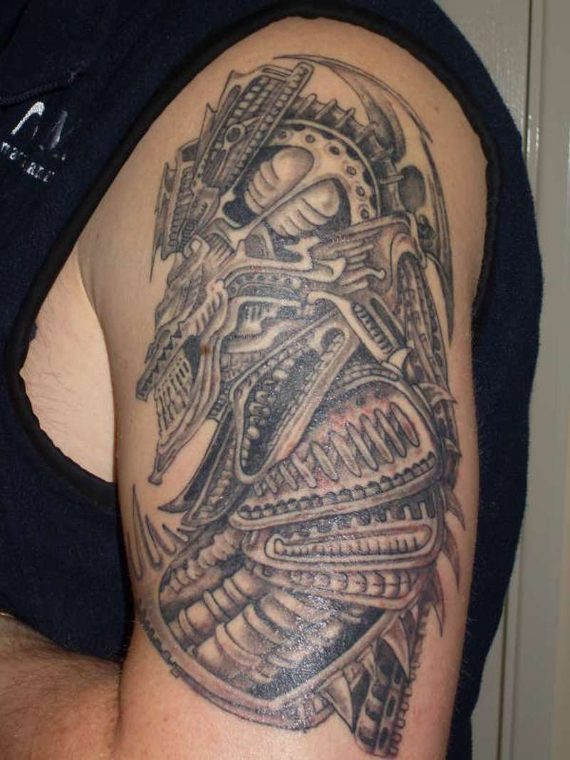 Biomechanical alien tattoo design