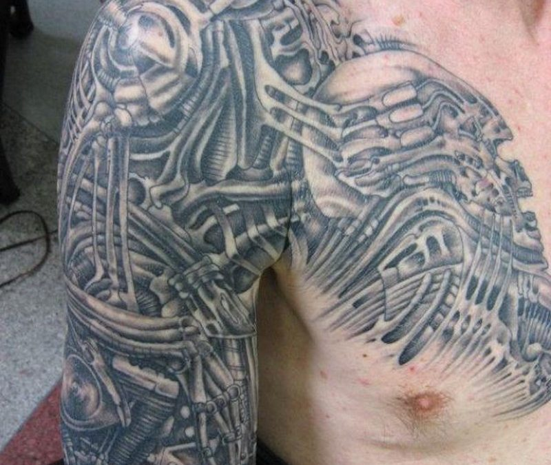 Biomechanical alien tattoo on shoulder chest and arm