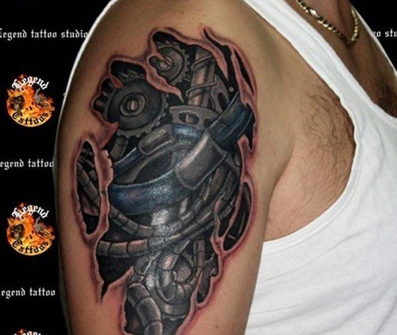 Biomechanical biceps tattoo