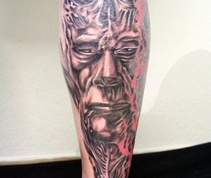 Biomechanical calf tattoo for men
