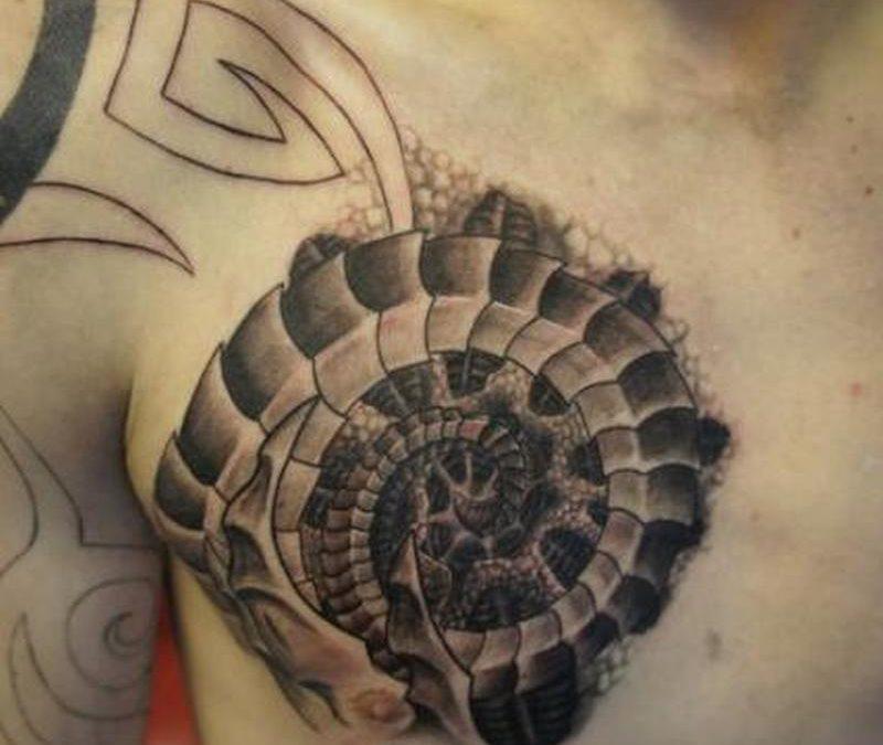 Biomechanical chest tattoo design