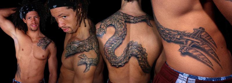 Biomechanical dragon tattoo design for men
