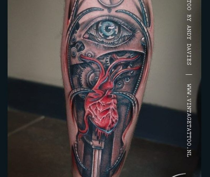 Biomechanical eye tattoo on leg