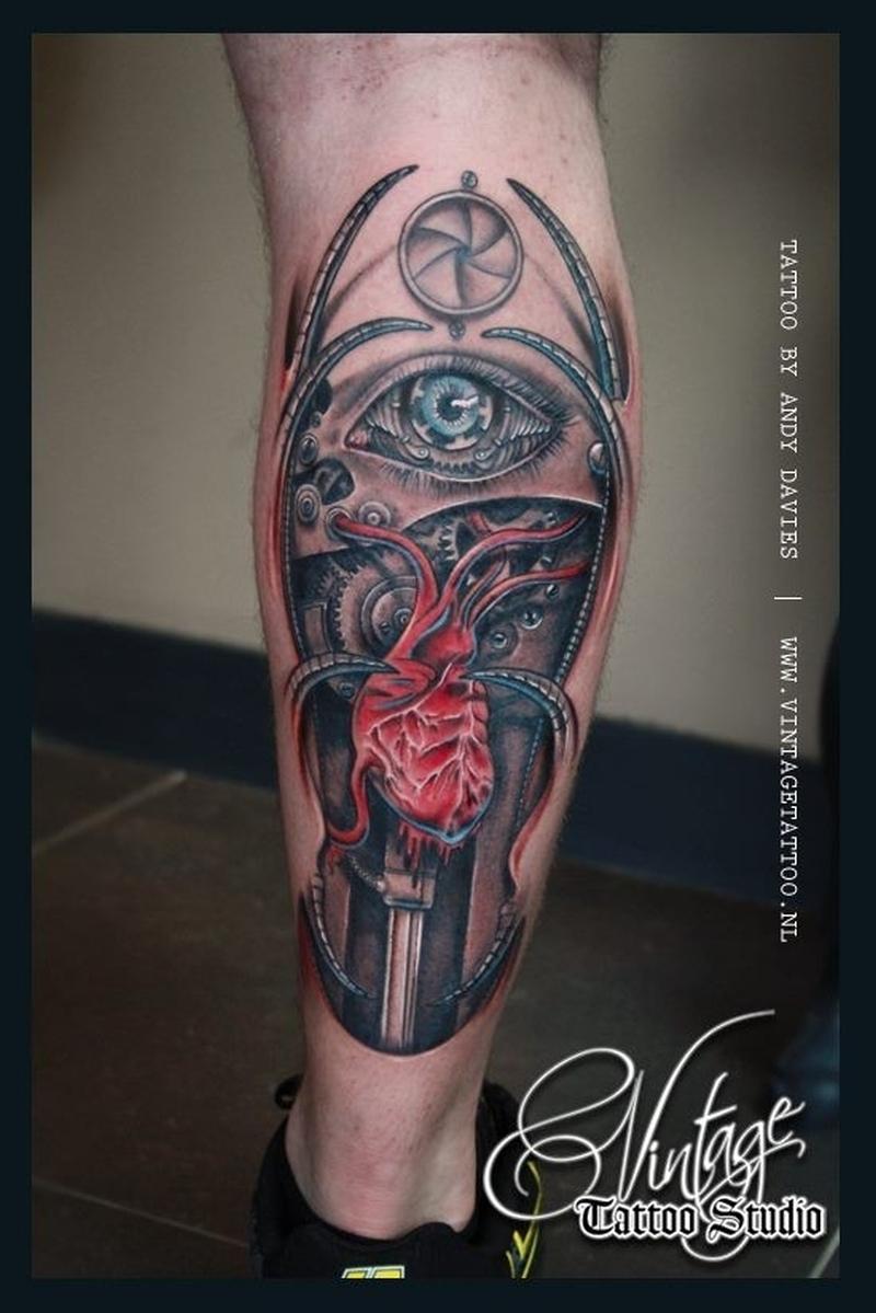 Biomechanical eye tattoo on leg