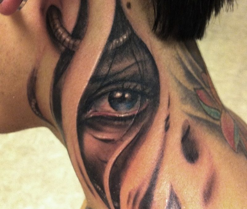 Biomechanical eye tattoo on neck for men