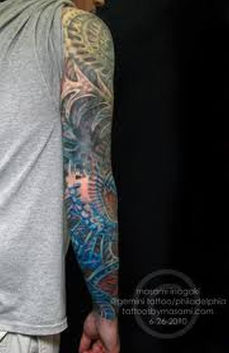 Biomechanical full arm alien tattoo