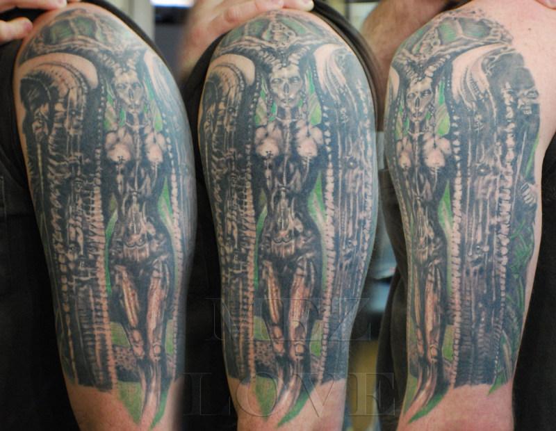 Biomechanical giger tattoo on biceps