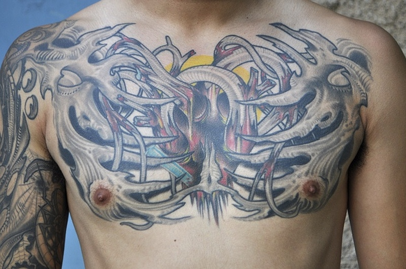 Biomechanical heart skeleton tattoo on chest
