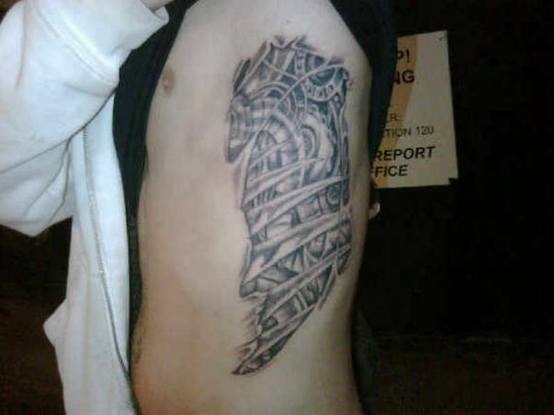 Biomechanical ribcage tattoo