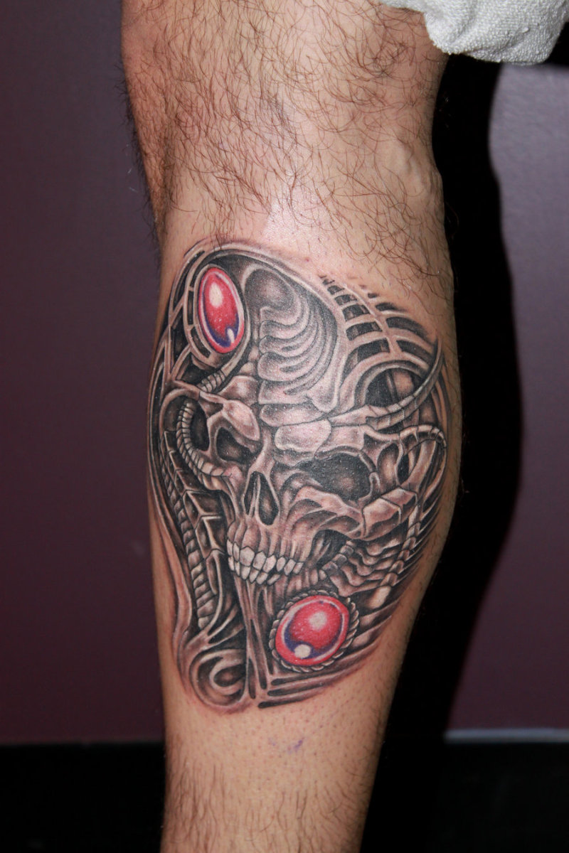 Biomechanical skull tattoo on leg