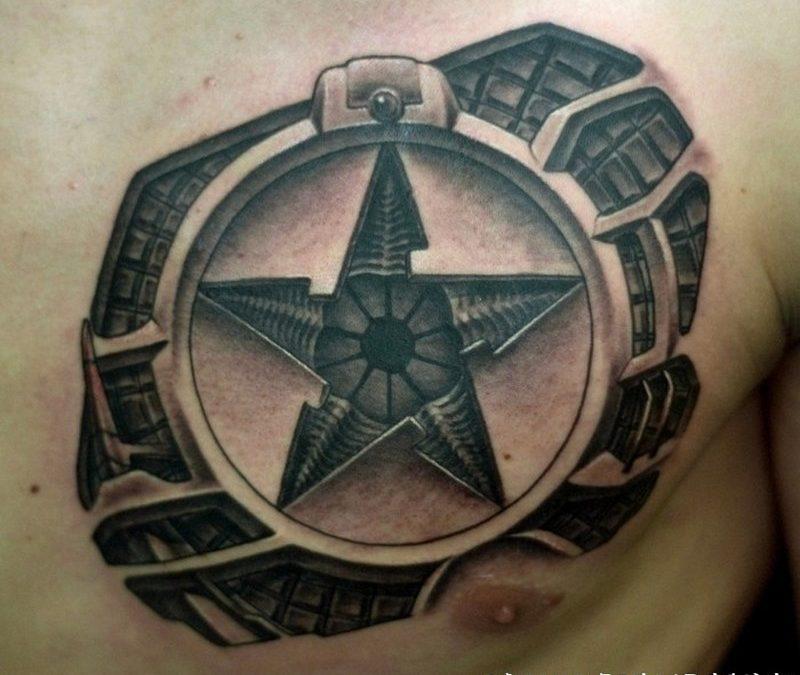 Biomechanical star tattoo on chest