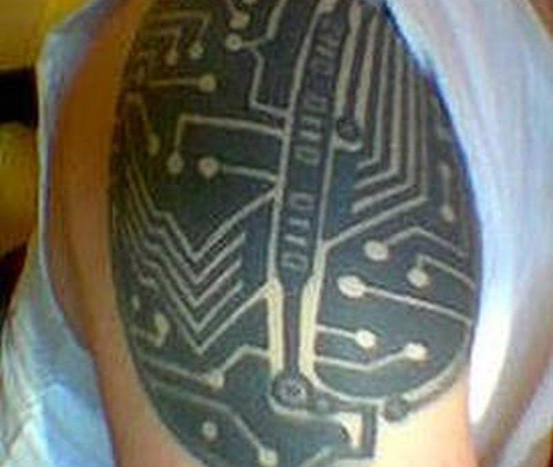 Biomechanical tattoo design on shoulder for men