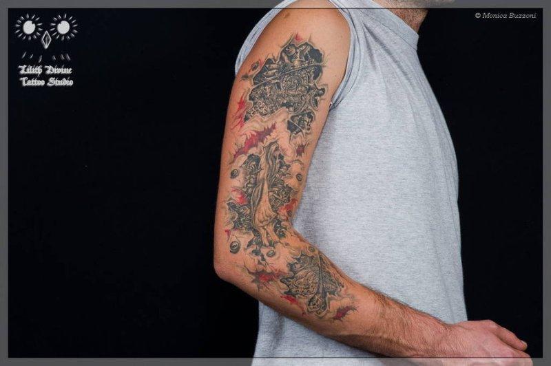 Biomechanical tattoo on arm for guys