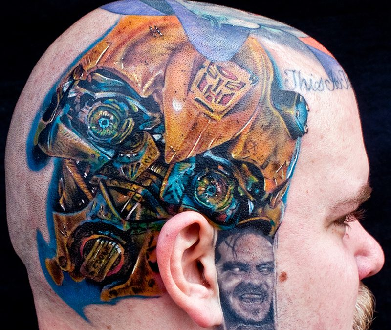 Biomechanical tattoo on head