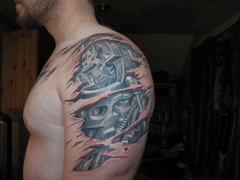 Biomechanical tattoo on shoulder arm