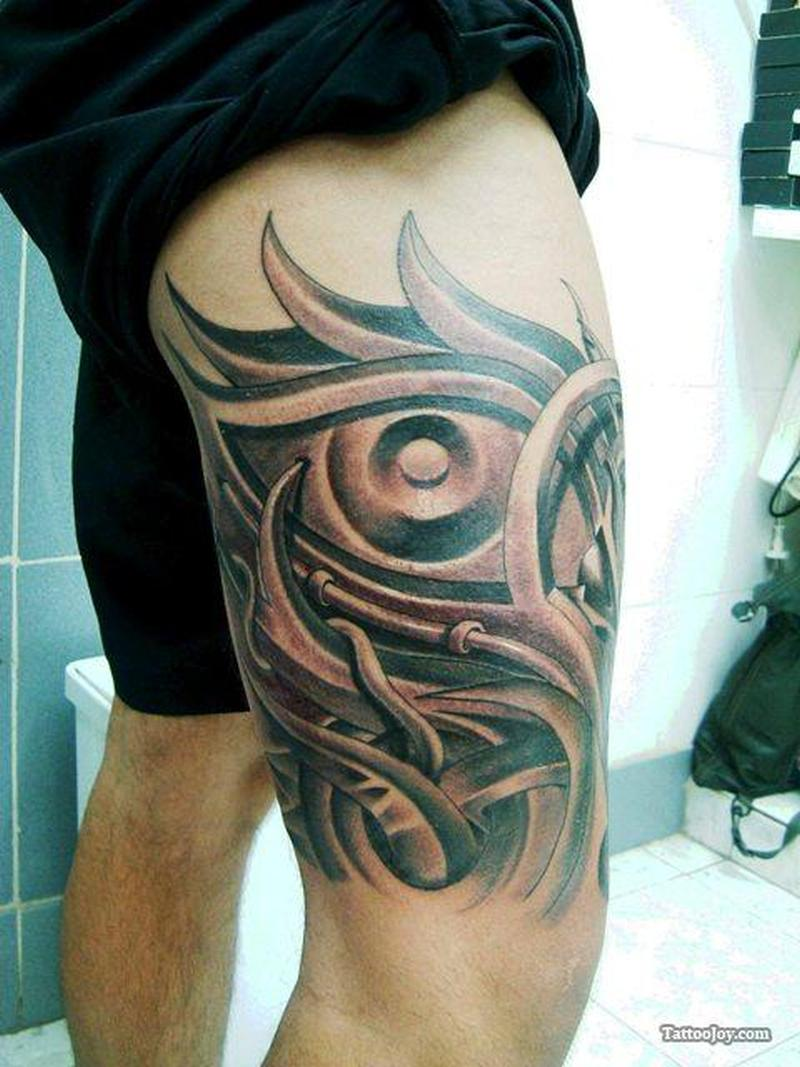 Biomechanical thigh tattoo