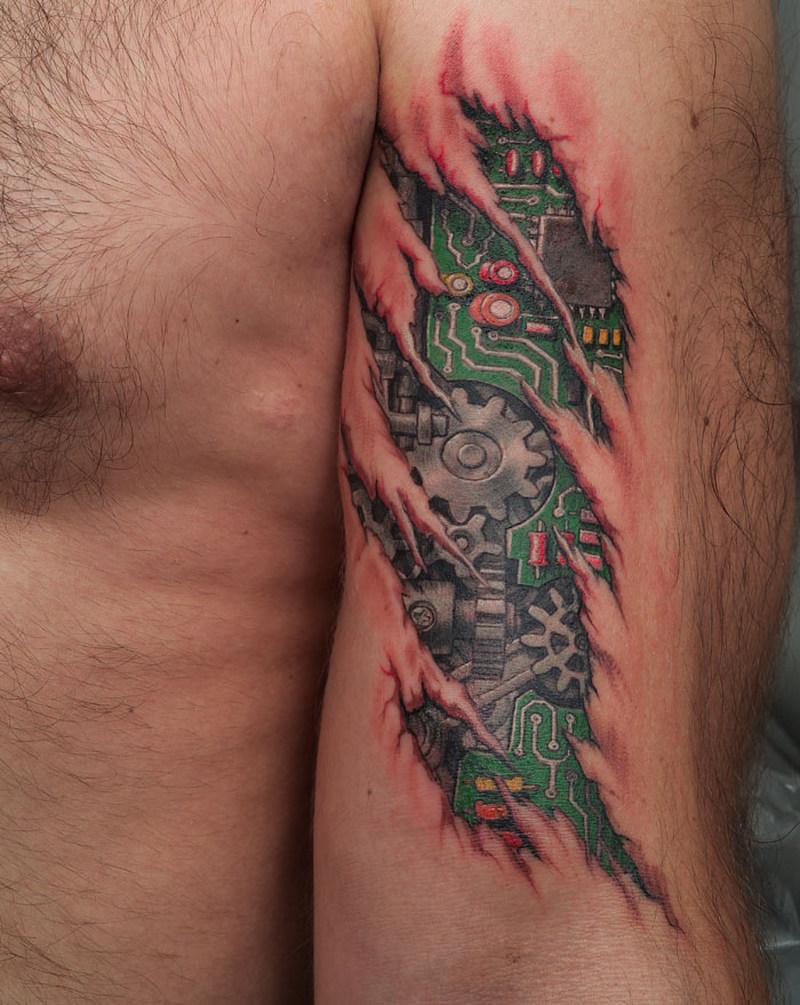 Biotech alien tattoo design on arm