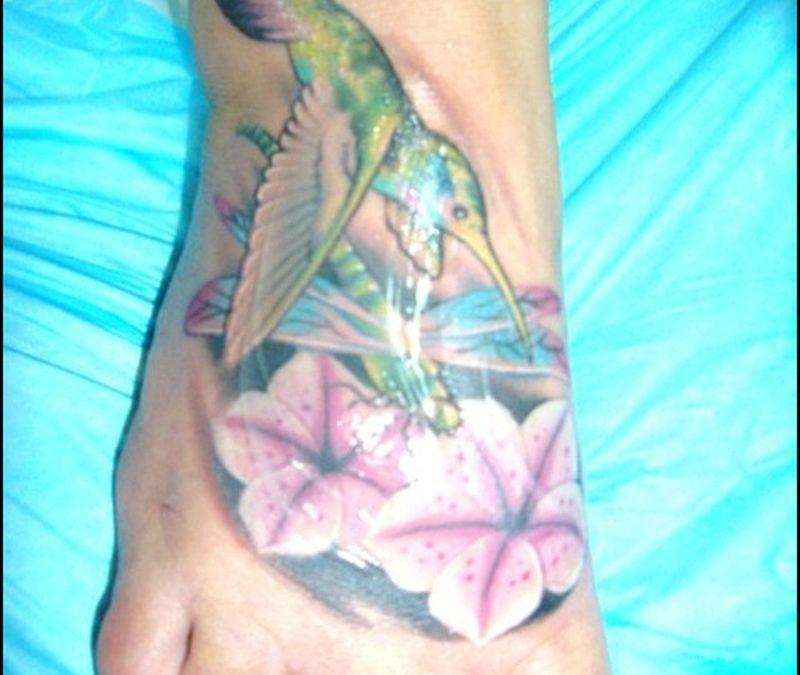 Bird dragonfly n flowers tattoo on foot