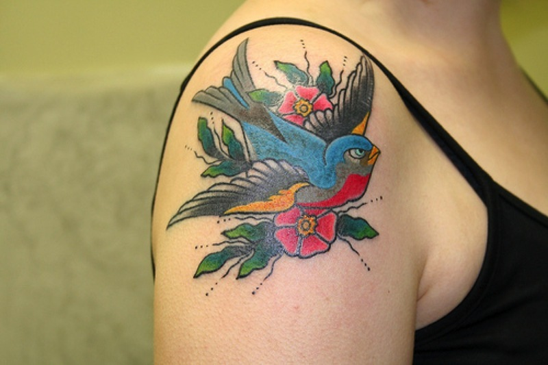 Bird flowers tattoo on shoulder