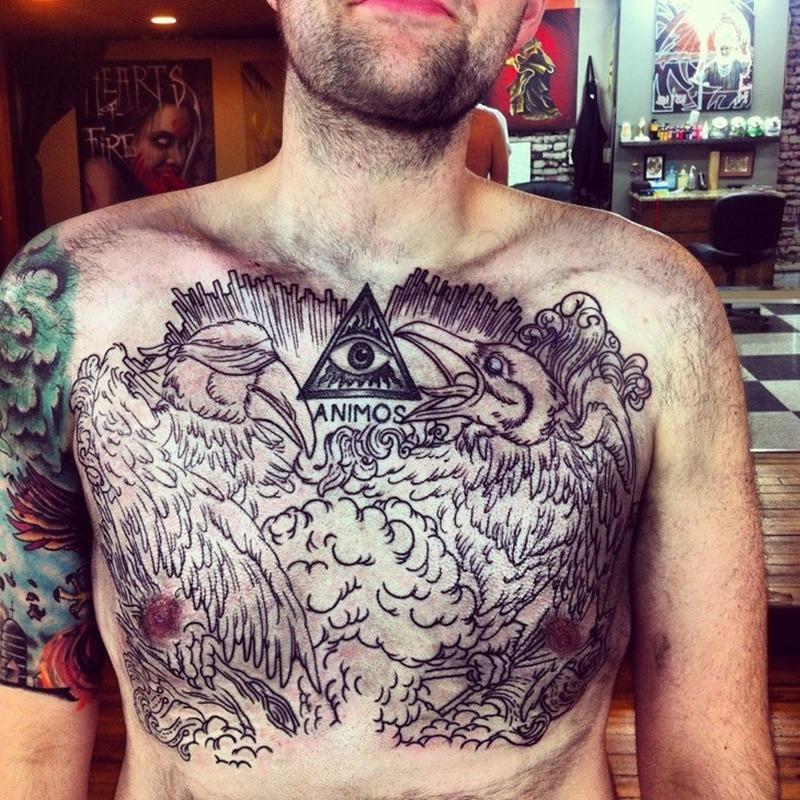 Bird n eye tattoo on chest for men