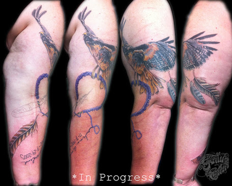 Bird n feather tattoo on arm