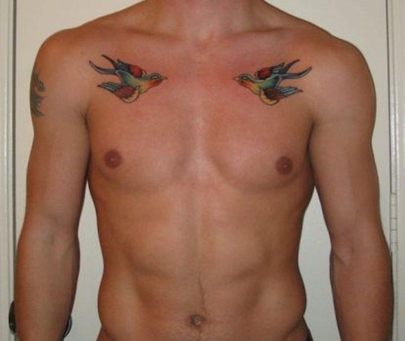 Bird tattoo design on chest of man