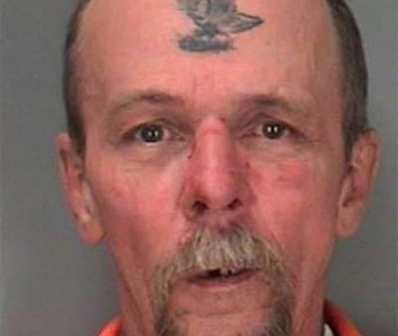 Bird tattoo on forehead of old guy