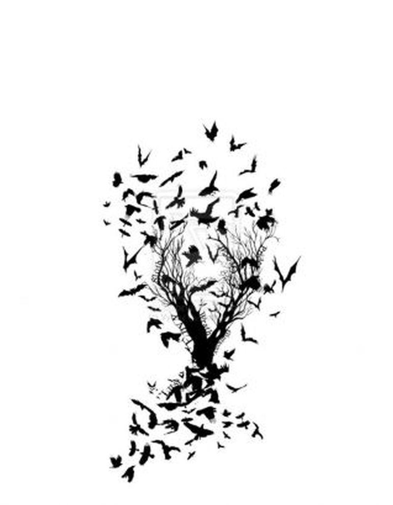 Birds bat tattoo flying on tree