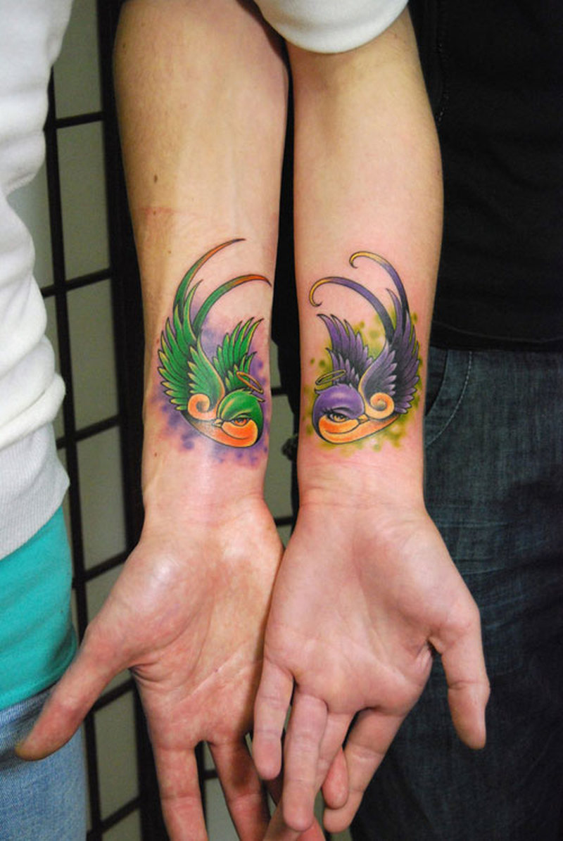 Birds couple tattoo