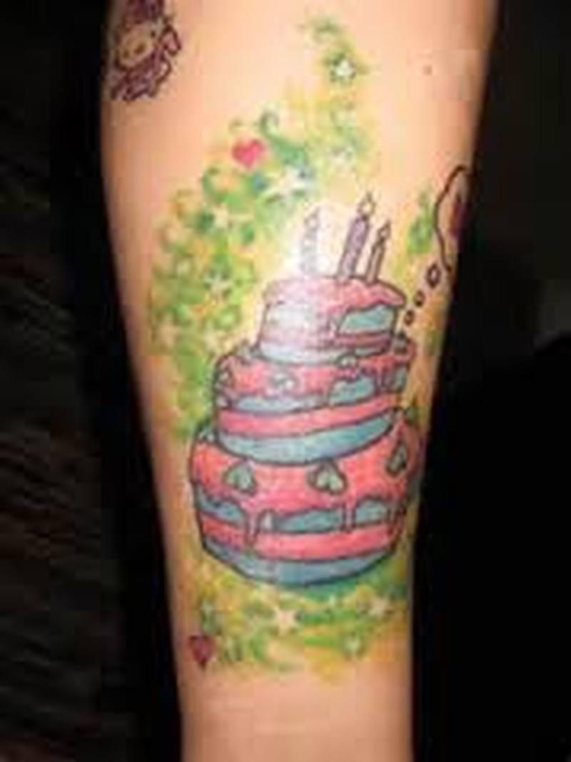 Birthday cake tattoo design