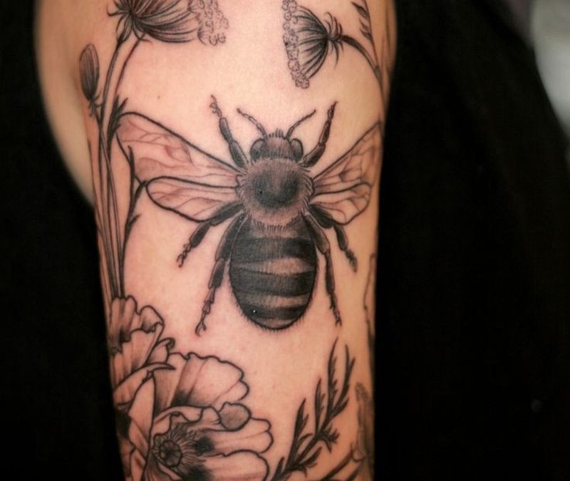 Black and grey bee and flowers tattoo by Alice Carrier