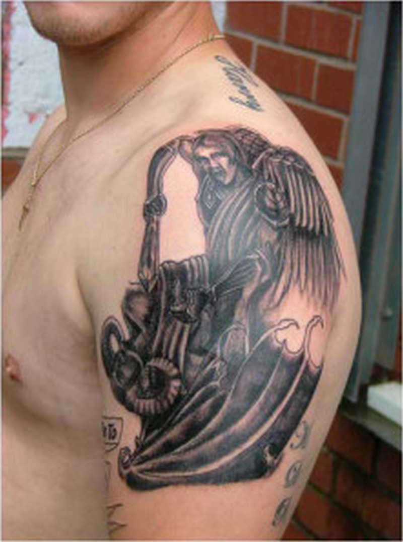 Black angel devil tattoo design on shoulder