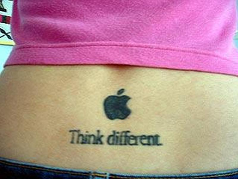 Black apple logo tattoo on lower back