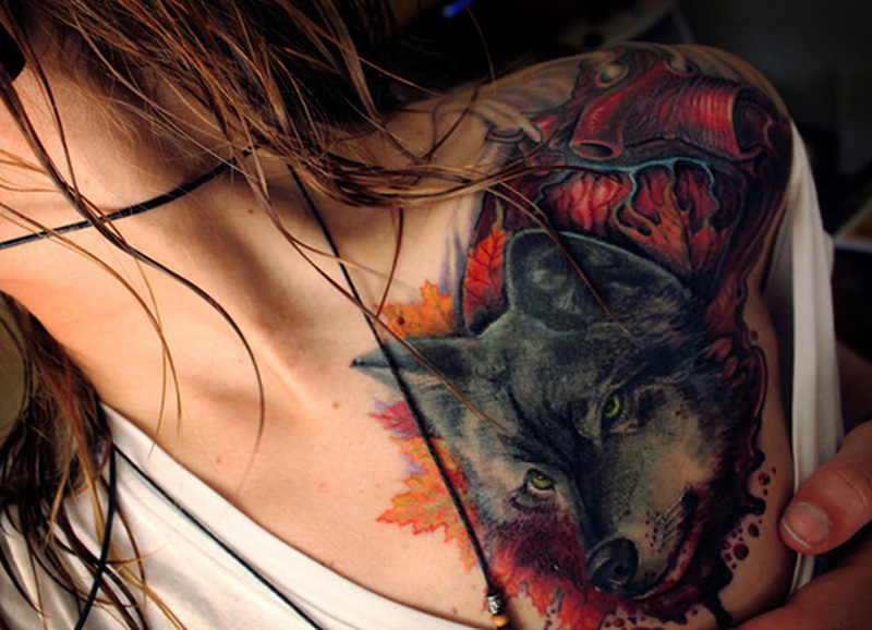 Black bear face heart tattoo on shoulder