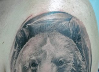 0d2f013f8 Black bear face tattoo on shoulder